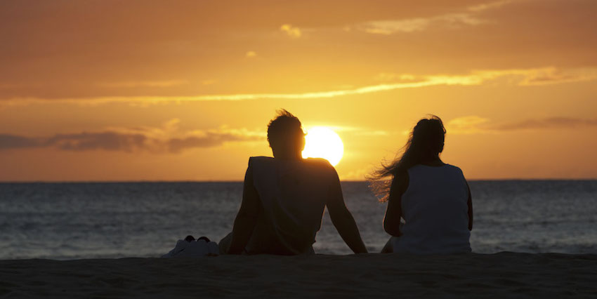 Couple enjoying beach sunset views
